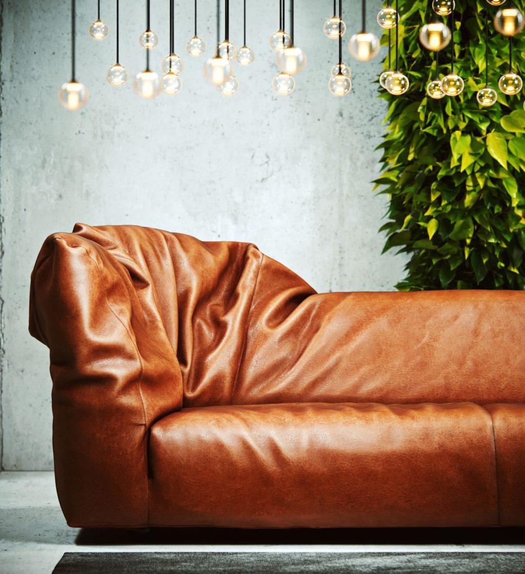 Wizualizacja brązowej sofy z dużą liczbą wiszących lamp